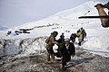 SSG Jonathan Hill, from the 438th Air Expeditionary Advisory Squadron, directs villagers to his helicopter on a rescue mission in Badakshan province, Afghanistan after an avalanche.jpg