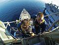Sailors replace a circuit board. (15811663566).jpg