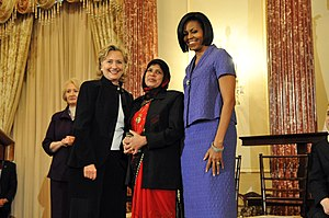 Jansila Majeed - Jansila Majeed (center) with US Secretary of State Hillary Clinton (left) and US First Lady Michelle Obama (right)