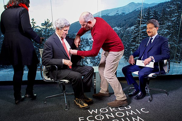 Secretary Kerry Receives a Microphone Before an Interview With Sky Arabia Host Muahmmed Le at the World Economic Forum in Davos (32248769431).jpg