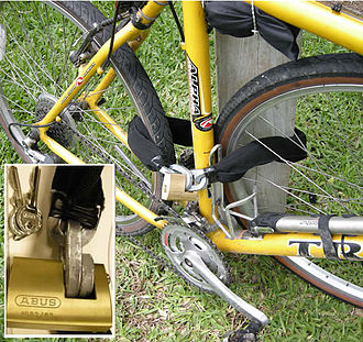 Bicycle lock - Proper use of a Case hardened security chain and monobloc padlock to secure a bicycle.