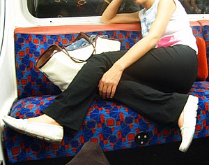 Online shaming - A woman taking up empty seats on the London Underground