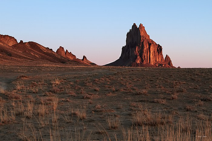 "Shiprock (Navajo: Tsé Bit'a'í, ""rock with wings"" ), located in traditional Dinétah territory (northwestern New Mexico)."