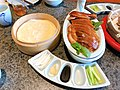Sliced Peking Duck with traditional condiments.jpg