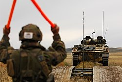 Soldier Guiding Tank Over Bridge MOD 45148903.jpg