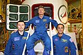 Soyuz TMA-04M crew members in front of their spacecraft.jpg