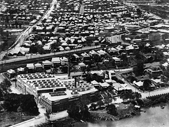 Petrie Terrace, Queensland - Aerial view of Petrie Terrace, ca. 1925. Morrows biscuit factory (later to become Arnott Morrows) on River Road (renamed Coronation Drive in 1937), Milton, in the foreground.