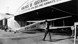 Archerfield Airport - De Havilland DH89 biplane pictured outside a hangar at the airfield, Archerfield, ca. 1937