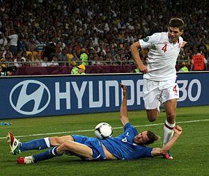 Sliding tackle - Federico Balzaretti (blue) slide tackles Steven Gerrard (white) at Euro 2012.