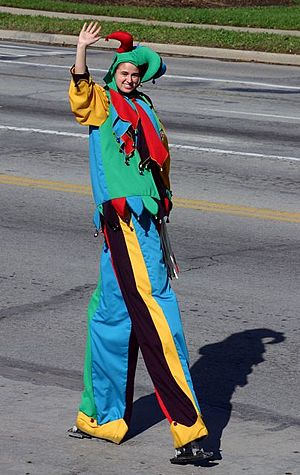 Stilts - Stiltwalker participates in a parade, dressed as a court jester
