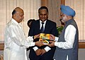 Sushil Kumar Shinde presenting a book, 'Towards Powering India Policy Initiatives and Implementation Strategy' written by Shri R.V.Shahi, to the Prime Minister, Dr. Manmohan Singh in New Delhi on November 10, 2007.jpg