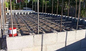 Concrete slab - Suspended slab formwork and rebar in place, ready for concrete pour. On reinforced concrete blockwork supporting walls