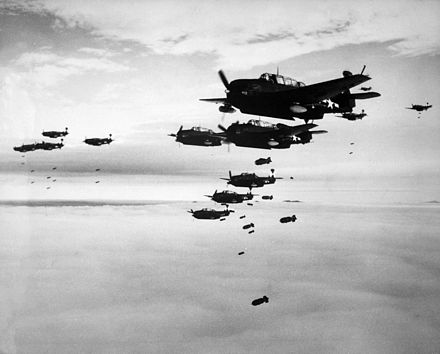 US Navy Grumman TBF Avenger aircraft dropping bombs on Hakodate during July 1945 TBMs and SB2Cs dropping bombs.jpg