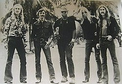 The musicians standing in a line, facing the camera
