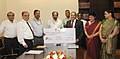 The Chairman and Managing Director, Oil India Ltd., Shri Sunil Kumar Srivastava presenting a dividend cheque to the Union Minister for Petroleum & Natural Gas, Dr. M. Veerappa Moily, in New Delhi on October 15, 2013.jpg