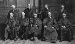 Equal justice under law - Chief Justice Fuller (front center) wrote for a unanimous Court in Caldwell.  In this 1899 photo, Justice Harlan is seated to his right, and Justice Peckham is standing to Harlan's right.