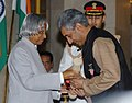The President, Dr. A.P.J. Abdul Kalam presenting Padma Shri to a Hindustani classical vocalist Shri Madhup Mudgal, at investiture ceremony in New Delhi on March 29, 2006.jpg
