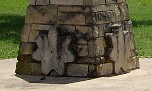 Peabody, Kansas - Cross sections of a Threshing stone on Mennonite monument. (2010)