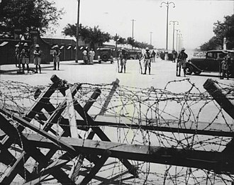 Tientsin incident - British soldiers behind the barbed wire barricade erected by the Japanese around the British and French concessions in Tientsin in June 1939