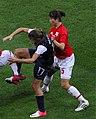Tobin Heath vs Nahomi Kawasumi and Aya Sameshima, 2012 Olympic gold medal match (cropped).jpg
