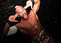 Tommaso Ciampa fingers to head.jpg