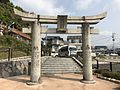 Torii of Tomioka Temman Shrine in front of Takeo-Onsen Station.jpg