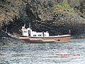 Tourist boat alongside at Staffa Island - panoramio.jpg