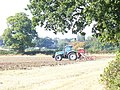Tractor at work by Barnes Lane - geograph.org.uk - 1513370.jpg