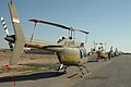 Two Bell Jet Ranger 206B helicopters sit behind a line of OH-58's at Kirkuk Regional Air Base,.jpg