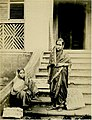Two Brahmin girls infront of a house in 1855.jpg