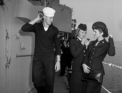 Two WAVES and a sailor aboard USS Uhlman (DD-687) at Terminal Island, California (USA), in 1950.jpg