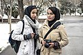 Two woman with camera in mellat park of Mashhad, winter.jpg