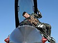 U.S.A.F Capt. Joseph White of the 22nd Fighter Squadron, makes final preparations for a flight in an F-16CJ Fighting Falcon at the U.S.A.F Weapons School, Nellis Air Force Base, Jan. 29, 2009.jpg