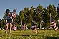 U.S. Air Force Senior Airman Kaila Kelly, an aviation resource manager with the 57th Weapons School, places flags on veterans' graves at the Southern Nevada Veterans Memorial Cemetery in Boulder City, Nev 130528-F-AQ406-062.jpg