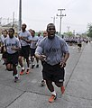 U.S. Army Master Sgt. Theodore Turner, with the 501st Special Troops Battalion, calls cadence out to his fellow Soldiers during a run to celebrate the U.S. Army's 239th Birthday at Camp Carroll, South Korea 140613-A-NY467-002.jpg