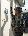 U.S. Army Sgt. Aaron Butterfield, with Delta Company, 3rd Combat Aviation Brigade, 3rd Infantry Division, Task Force (TF) Knighthawk, TF-Falcon, knocks on the door of the TF-Falcon Soldier of the Year boardroom 100916-A-BL368-072.jpg