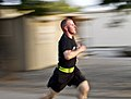 U.S. Army Sgt. Kyle France, a cannon crew member with the 4th Battalion, 320th Field Artillery Regiment, 4th Brigade Combat Team, 101st Airborne Division, sprints as he approaches the finish line of a 2-mile run 130714-A-DQ133-516.jpg