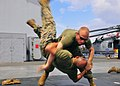 U.S. Marine Corps Capt. Chris Tucker, top, and Sgt. Gabriel Perez, both assigned to Fleet Anti-terrorism Security Team Pacific (FASTPAC), perform mixed martial arts techniques aboard the amphibious command ship 130528-N-QD718-186.jpg