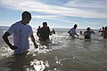 U.S. Marine Corps volunteers escort Polar Plunge participants safely back to the beach during the event on Onslow Beach, Camp Lejeune, N.C., Jan. 5, 2013 130105-M-JL652-128.jpg