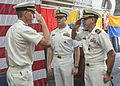 U.S. Navy Cmdr. Patrick C. Thien, right, the commanding officer of the littoral combat ship USS Freedom (LCS 1), relinquishes his duties as he salutes Capt. Randy Garner, the commodore of Littoral Combat Ship 131215-N-QF605-020.jpg
