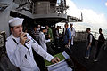 U.S. Navy Interior Communications Specialist Second Class Paul Lewis stands the Petty Officer of the Watch as Sailors return from liberty aboard USS Ronald Reagan (CVN 76) while moored in Hong Kong harbor 080619-N-HX866-003.jpg