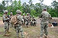 U.S. Sailors assigned to Naval Mobile Construction Battalion 11 receive feedback from evaluators with Naval Construction Group 2 while participating in a field exercise (FEX) at Camp Shelby, Miss., May 11, 2013 130511-N-UH337-043.jpg