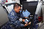 USS George H.W. Bush sailors at work 121101-N-UE260-039.jpg