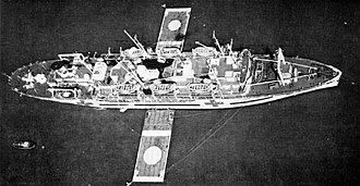 USS Haven (AH-12) - Haven with helicopter landing platforms moored on each side, 1952.