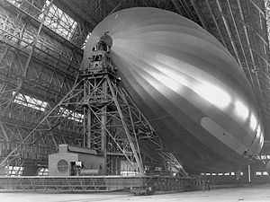 English: USS Macon docked inside Hangar One at...