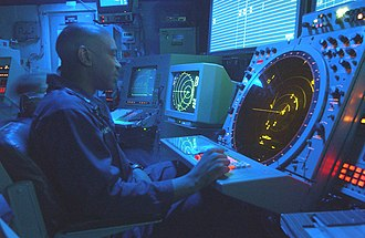USS Theodore Roosevelt (CVN-71) - An air traffic controller watches his radar scope in the Carrier Air Traffic Control Center