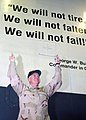 US Navy 030415-N-8693O-002 Vice Adm. Timothy J. Keating, Commander, Fifth Fleet uses a quote painted on the ship's hanger bay divisional doors We will not tire, we will not falter, we will not fail to represent the effor.jpg