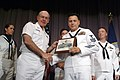 US Navy 030522-N-2383B-092 Machinist's Mate 1st Class Marc Medina accepts a plaque from Chief of Naval Operations (CNO) Adm. Vern Clark after being selected as the CNO Shore Sailor of the Year.jpg