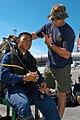 US Navy 030626-N-0493B-005 Operations Specialist 2nd Class Matthew Medeiros goes through pre-dive checks.jpg