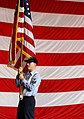 US Navy 030709-N-0696M-008 Personnelman 1st Class William E. Evans carries the National Ensign during color guard rehearsals in preparation for the ship's commissioning ceremony, scheduled for July 12th, 2003.jpg